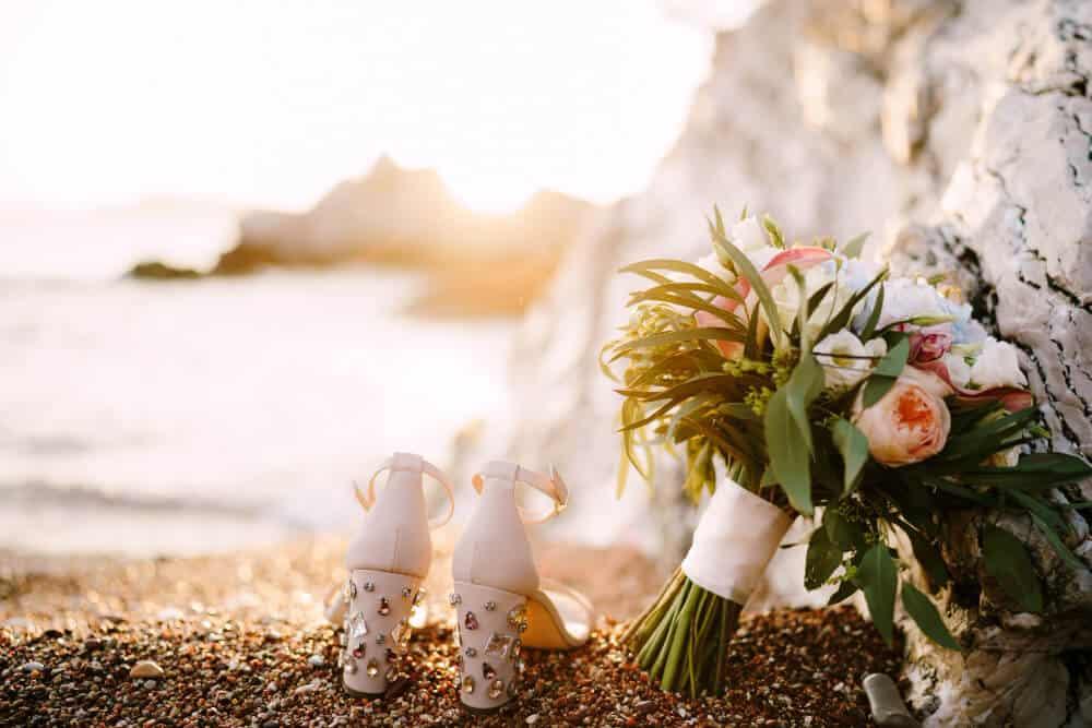 bridal shoes with rhinestones heels standing sea pebble beach bridal bouquet