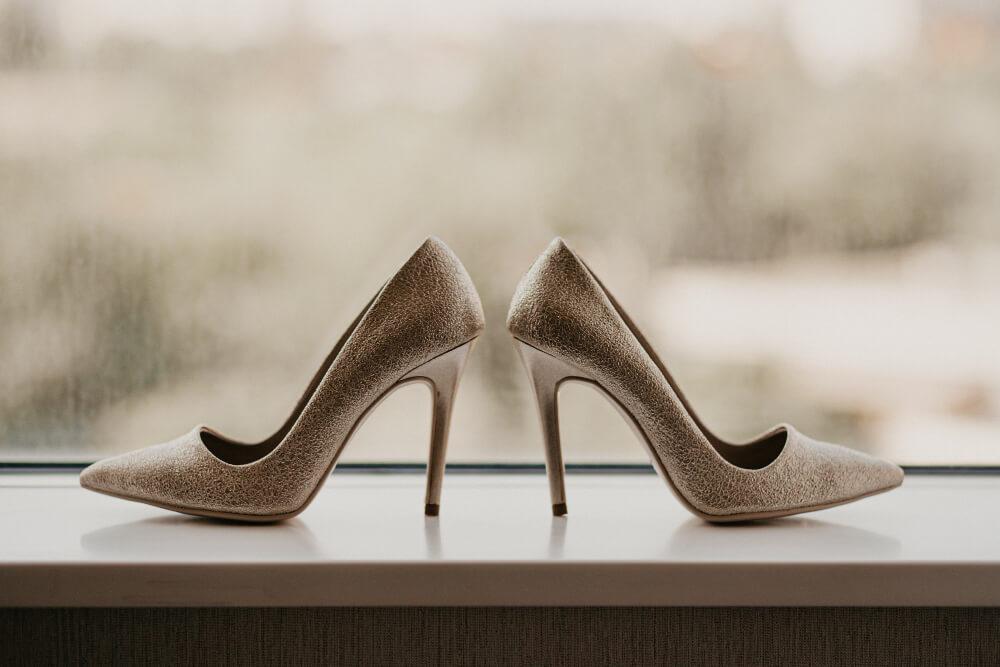 gold wedding rings pair golden high heel shoes