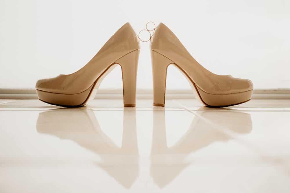 gold wedding rings pair white high heel shoes